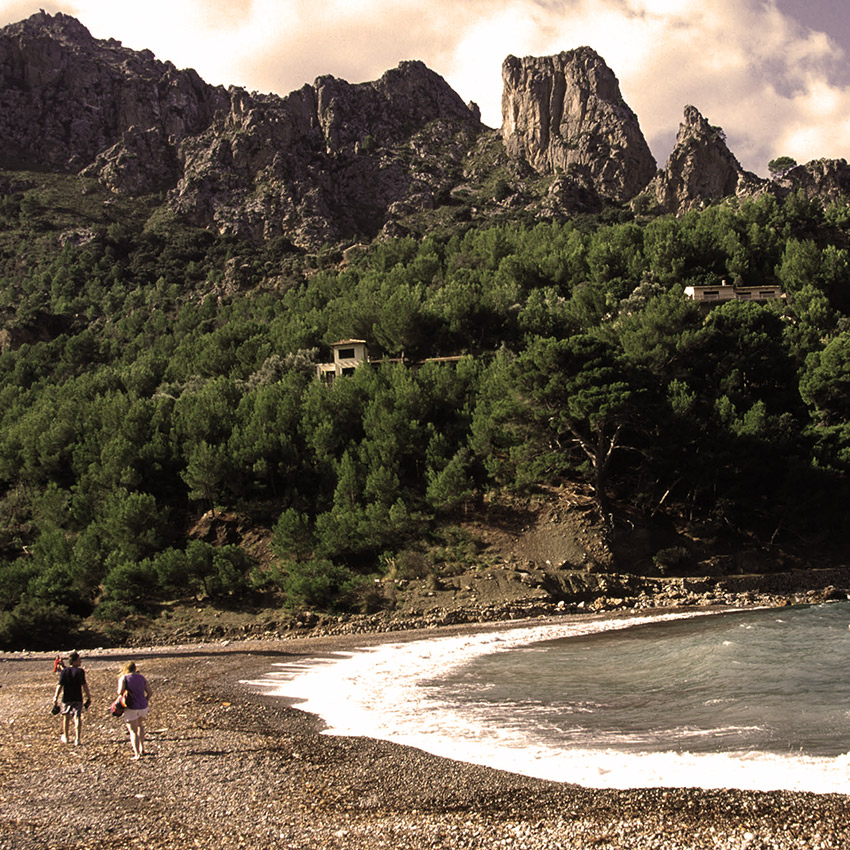 Walking in Majorca on the beach in Cala Tuent