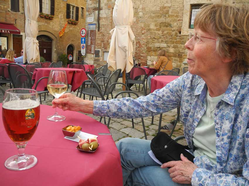 Enjoying a glass of wine and a beer Morreti La Rossa in Montepulciano